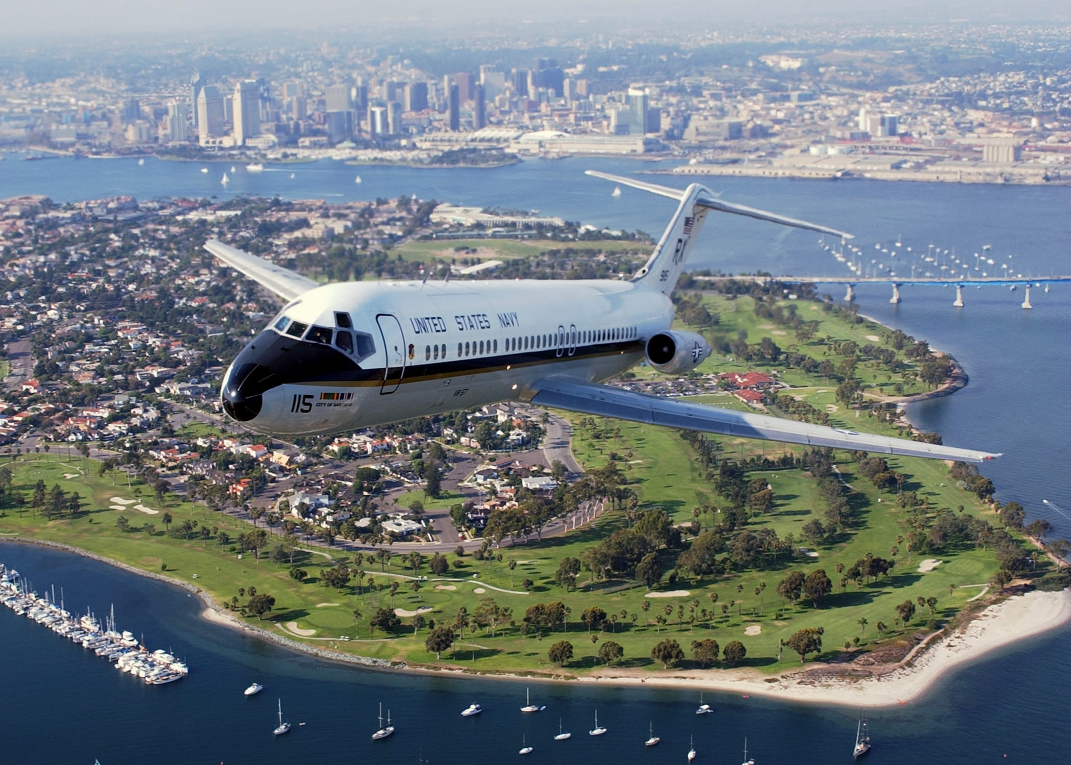 030819-N-6501M-005 San Diego, Calif. (Aug. 19, 2003) -- With the San Diego skyline in the background, a C-9B Skytrain II assign to the