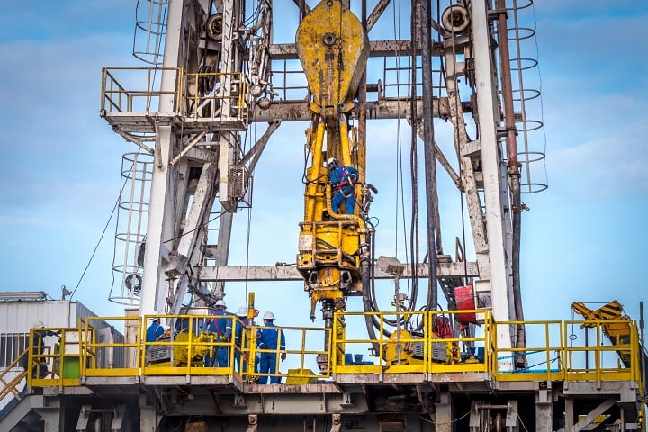 Offshore oil rig workers in dangerous environment