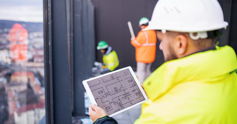property maintenance manager at work holding a tablet